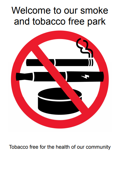 Welcome to our smoke and tobacco free park. Tobacco free for the health of our community. Cigarette, vape, smokeless tobacco canister red NO symbol