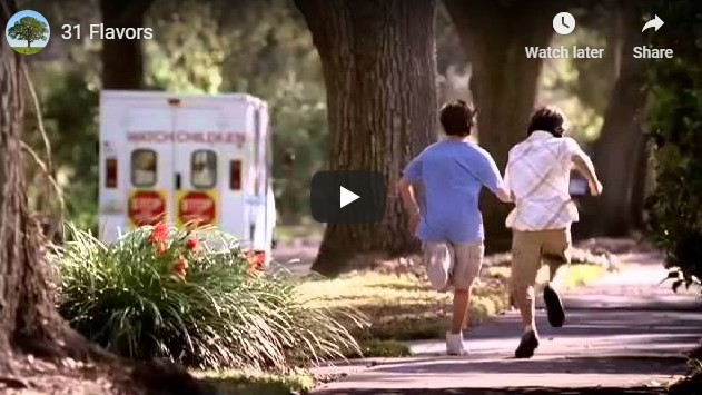 Two boys running on a sidewalk to catch an ice cream truck