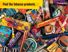 "A pile of all types of candy such as Starbursts and M&Ms is mixed in with flavored tobacco products and vape pens with the caption, ""Find the tobacco products."""