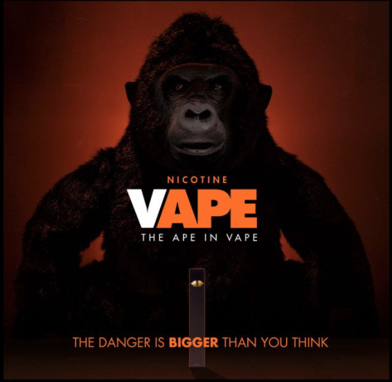 "Nicotine vape the ape in vape. The danger is bigger than you think. ""ape"" and ""bigger"" are highlighted. Gorilla in the background"